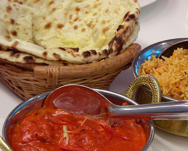 Curry with rice and naan bread.