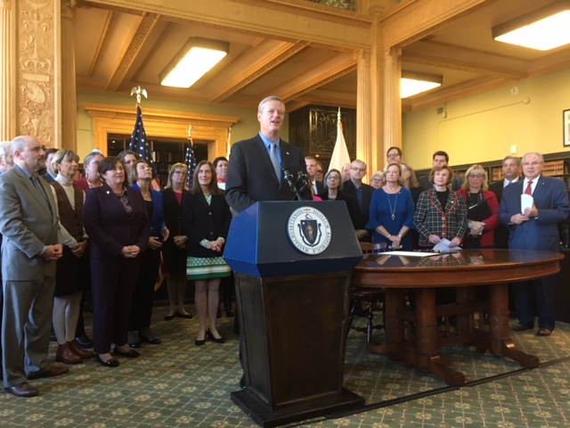 MEMBERS OF THE WOMEN'S CAUCUS AND MASSACHUSETTS LEGISLATURE ATTEND THE CEREMONIAL BILL SIGNING OF THE ACCESS BILL.