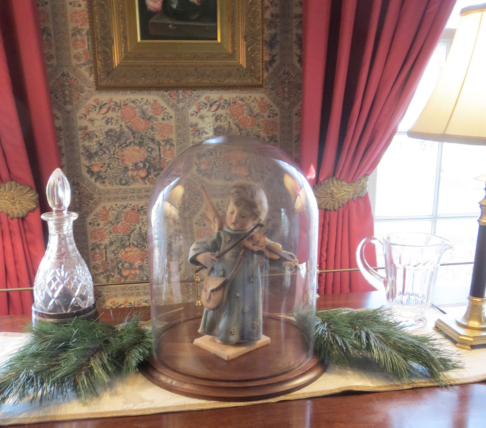 The Christmas Angel is seen here under a glass dome - the perfect addition to your Holiday decor. The angel can be used as a centerpiece on a Holiday buffet.