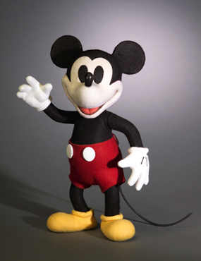 """Name: Mickey Mouse Description: All-felt, 12"""" tall, fully jointed, molded and hand painted features and leather nose and tail. Wearing trademark red shorts and yellow shoes. Date of Release: 2005 Edition Notes: Limited Edition: 500. Mickey Mouse was introduced at the Walt Disney World Teddy Bear and Doll Weekend and sold through """"THE ART OF DISNEY"""" galleries at Epcot Center (Phone: (407)-560-6481); and DOWNTOWN DISNEY (Phone: (407)-828-3929)"""