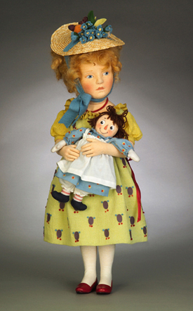"""Name: Marcella & Raggedy Ann Description: Description:17"""" tall, fully jointed and made of all-wool felt with a mohair wig and hand-painted facial features. Outfitted in cotton gauze dress with felt applique pattern; straw hat with felt flowers and fruit; cream cotton stockings and leather slippers. Holds an all-felt 6"""" Raggedy Ann doll. Date of Release: 2005 Edition Notes: Limited Edition 250."""