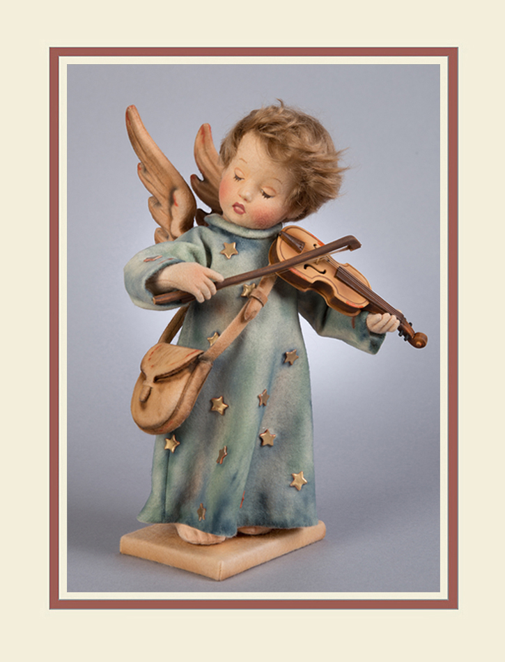 """The third issue in the RJW Hummel® collection is the beautiful """"Celestial Musician"""" based on an original illustration by Sister Marie Innocentia. The Celestial Musician is made entirely of the finest all-wool felt. Fully jointed with the RJW ball & socket system with internal wood mechanism, the lovely angel child stands approximately 12"""" tall. This is the first RJW Hummel to feature the distinctive lowered eye lids. The molded felt head has delicately hand painted features, and a wig of the finest mohair. The expressive hands have individually-sewn fingers and sculptural details. The Celestial Musician comes costumed in a classic all-felt gown with metallic star motif. The angel wings are beautifully sculpted and molded out of felt and delicately hand painted. The entire costume has been artistically shaded in subtle hues to evoke the original Hummel coloring perfectly. The little musician holds a custom-made violin and bow handcrafted out of wood at the R. John Wright Workshop. A satchel made of all-wool felt hangs on a strap from one shoulder. Every detail has been meticulously researched to capture the essence and emotion of the original Hummel® design. Each doll includes a felt-covered wooden stand with a metal rod which inserts into a leg for easy display."""