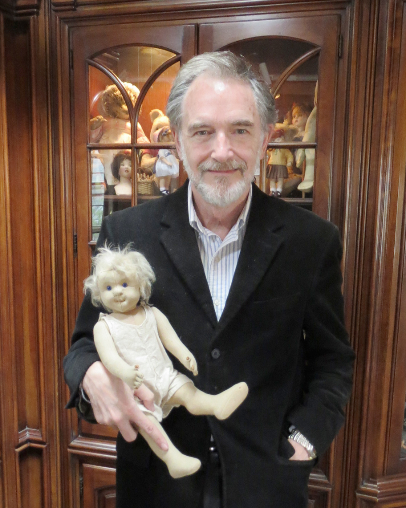 Here I am today in my office holding a large-size original Steiff doll circa 1911.