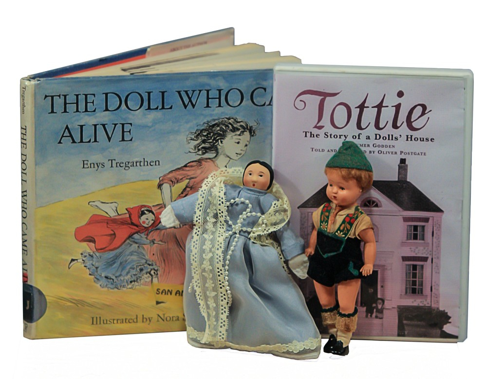 """One Version of Tottie, a book featuring a similar doll, a Celluloid """"Apple"""" and the DVD. This photo, and that of The Plantagenet Family below by my husband, Dino Milani."""