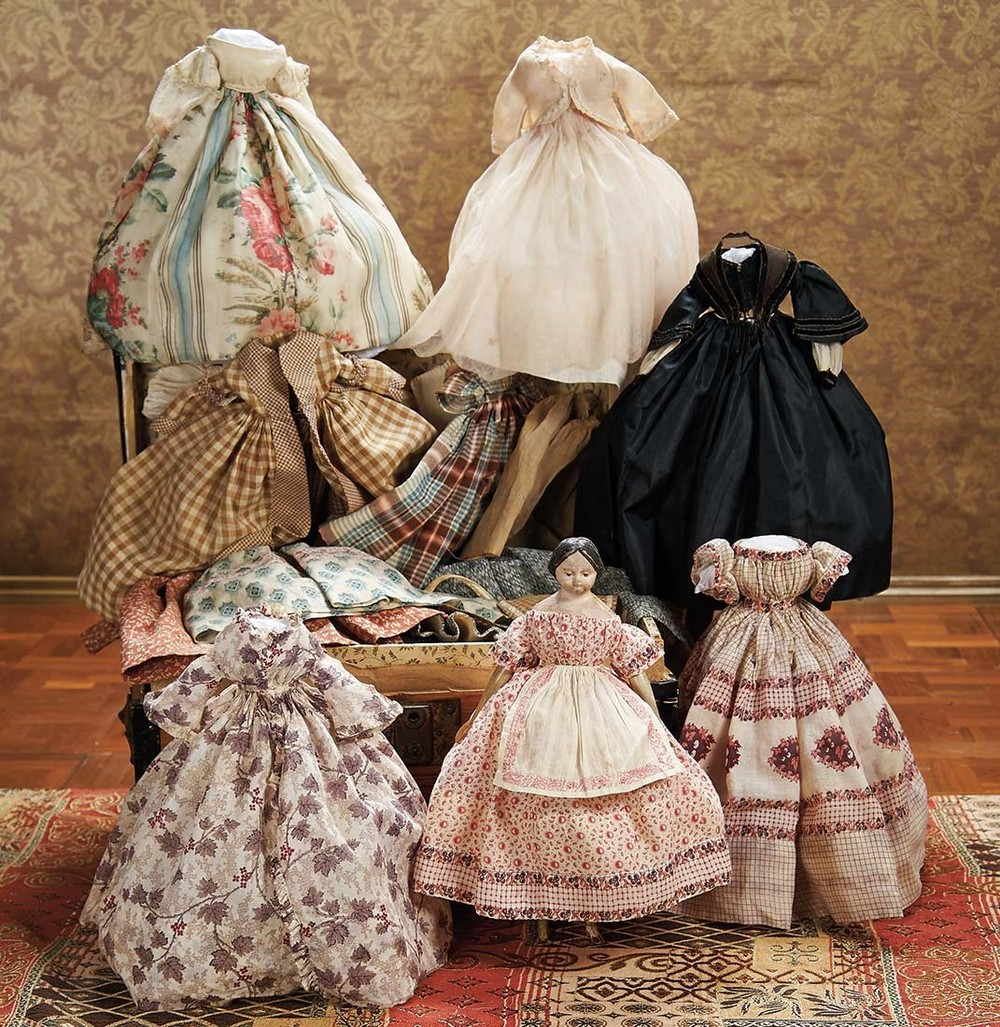 Small Papier Mache and her Wardrobe. Courtesy, Theriault's