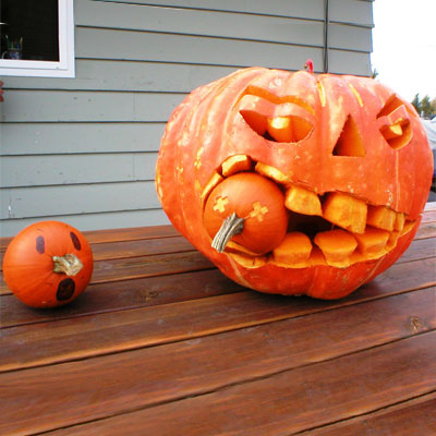 """This is a 75-pound pumpkin with two sweet pumpkins. I used a pumpkin carving kit, cordless drill, hammer and chisel."" Brian H. Troutdale, OR"