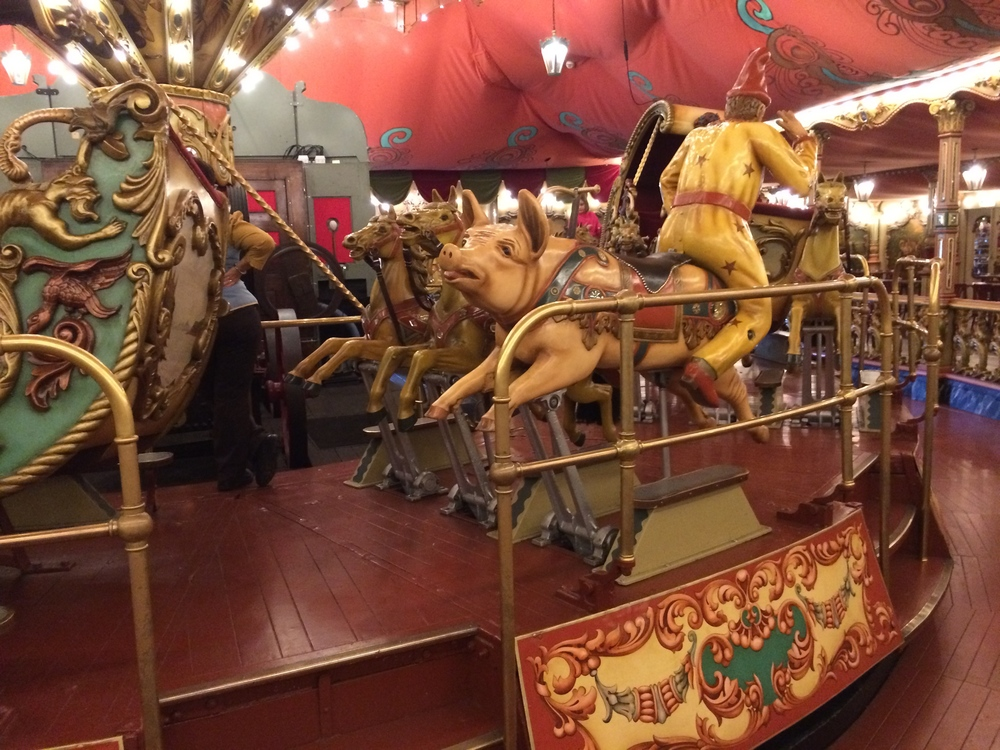 The carousel rotates clockwise.