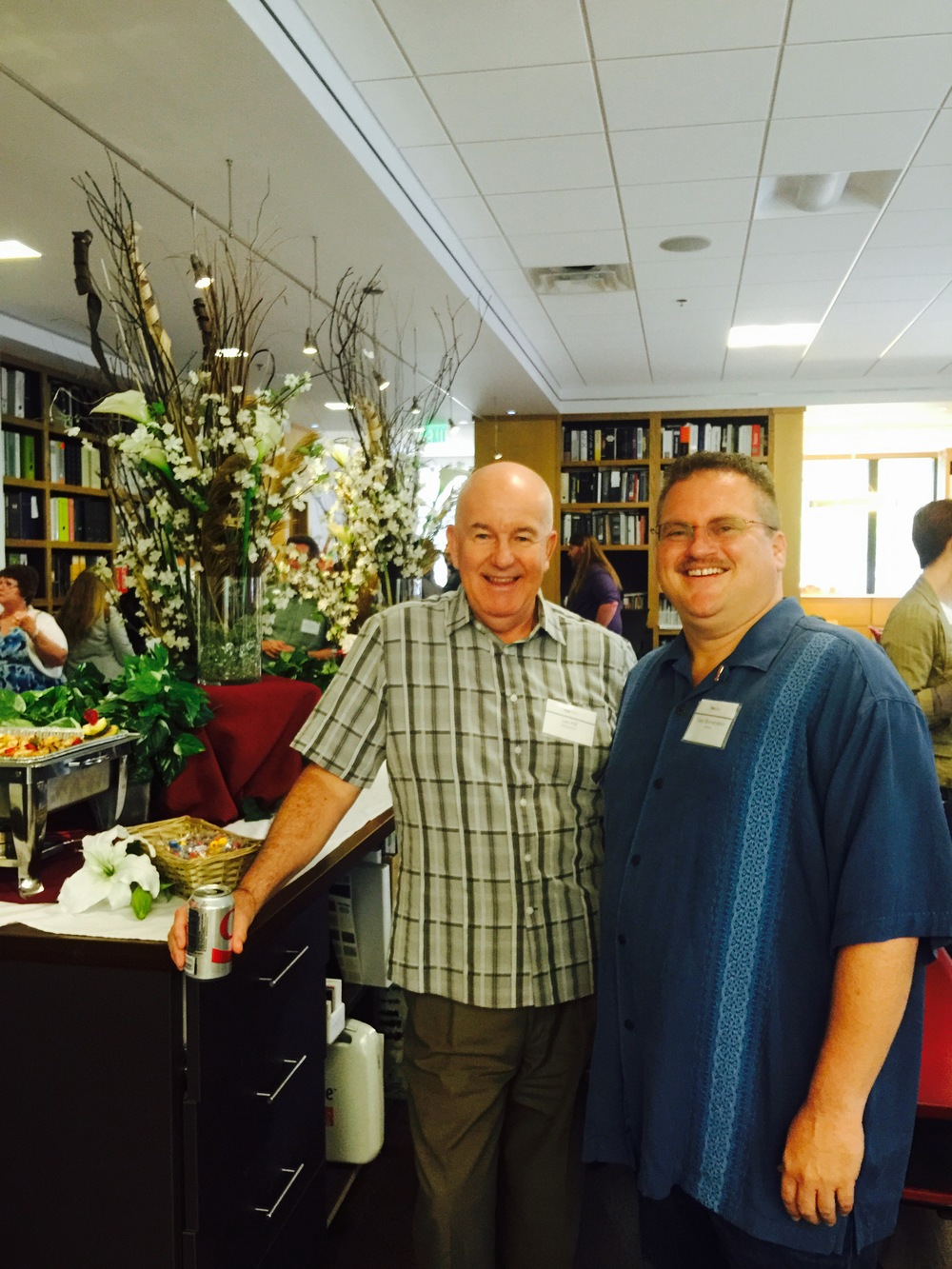 Les Hill of Electrosonic and Gary Blumenstein of Rethink meet up at the TEA's NextGen GibGab speed networking event.
