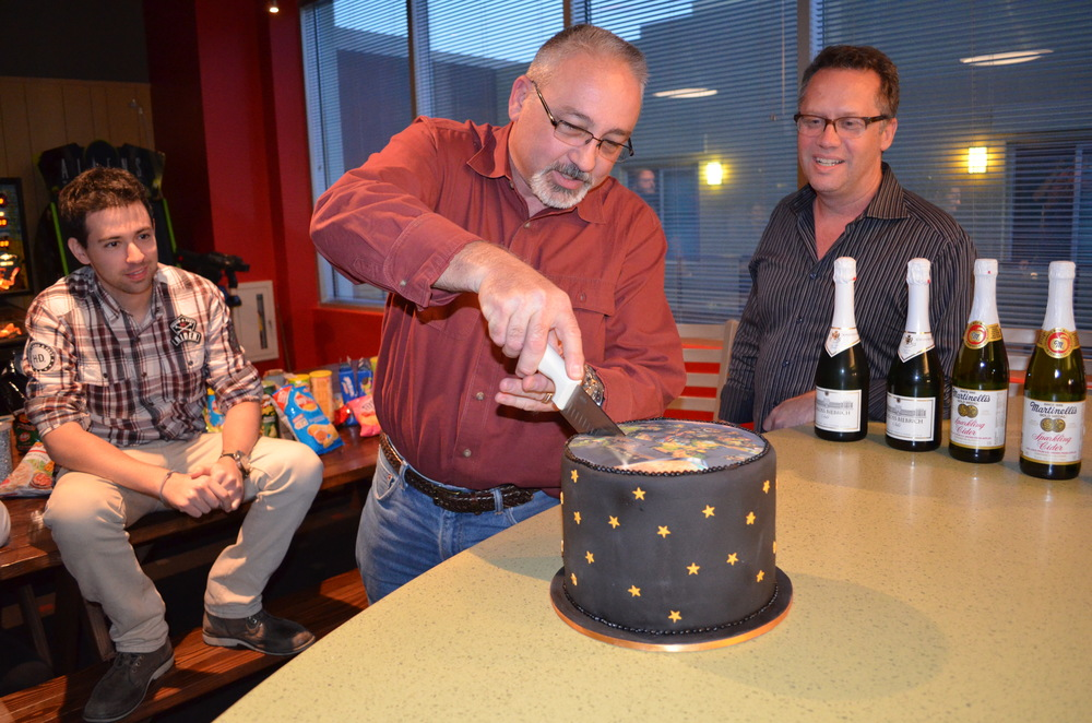 COO Mike Pharr cuts our ceremonial 20th Century Fox World Dubai cake, as Danny Greenberg and Scott Ault look on.