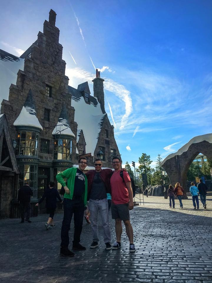 When walking in we realized it really looks a lot like Hogsmeade in UIOA with some subtle differences.  For one, as you can see behind us in the photograph, Olivanders wand shop is on the opposite side of the street in this iteration of the land.  This actually works out in the park's favor as now the attraction has two show rooms, and each one is larger than its Orlando predecessor.