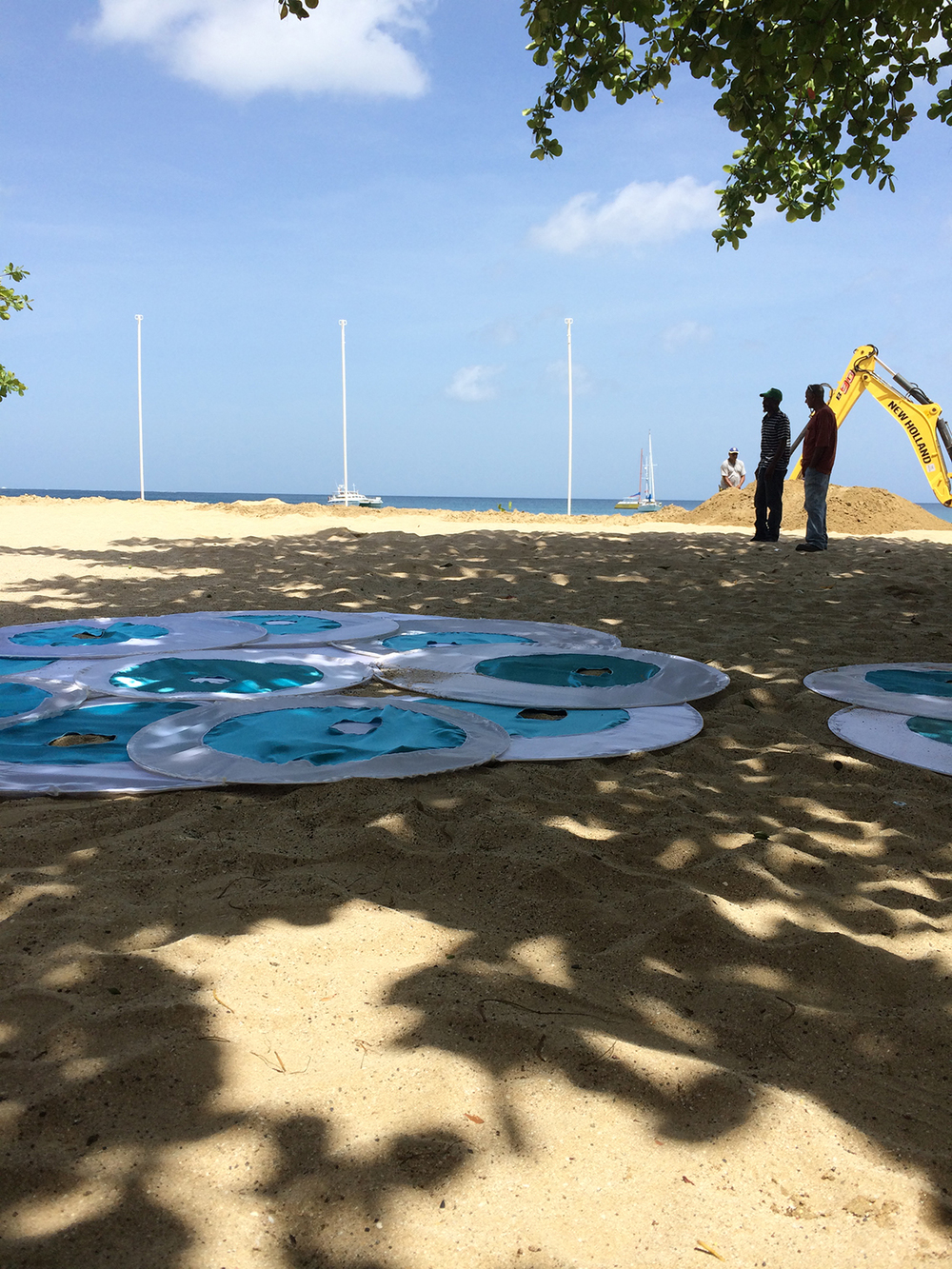 Shade being installed on the beach