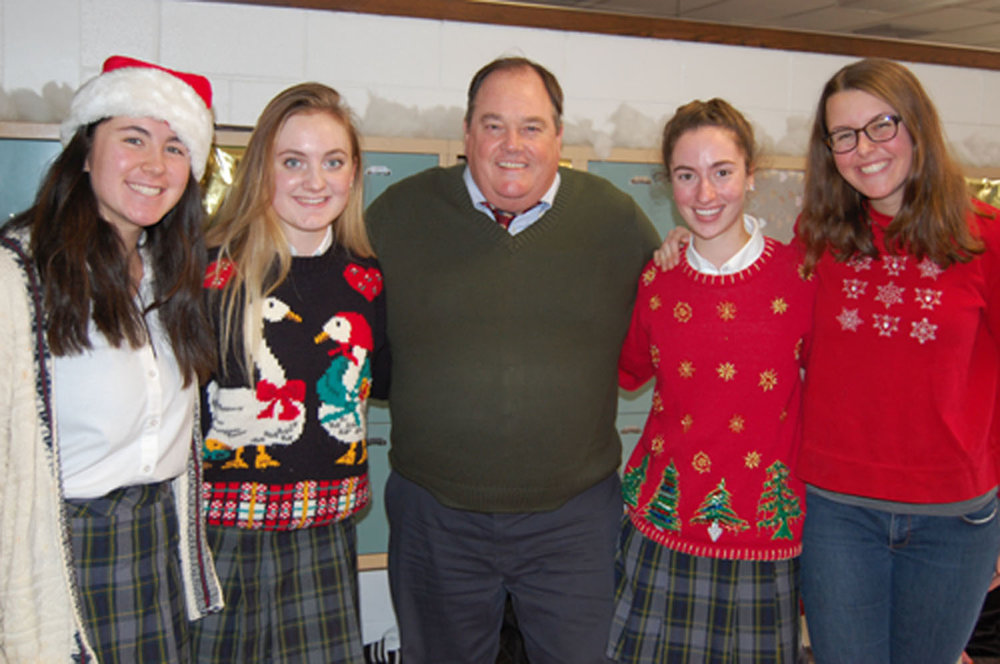 Academic  Dean Michael Gavin  stops for a picture during Deck the Halls with  Erin Wagner '18  and  Sara Jo Stokes '18 .