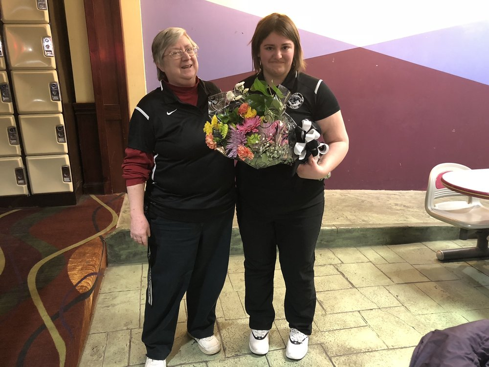 Elms Bowling  Coach Pat Kelley  congratulates  Rachael Saepic  during the team's senior night celebration.