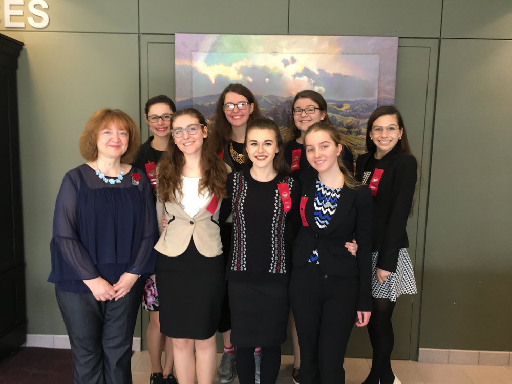Seven members of the Elms Speech and Debate team qualified to participate in the state tournament.  Pictured (l-r) are  Coach Elaine Fippin, Abigail Cox, Renee Coffman, Claire Heinle, Mercedes Farlin, Adeline Hatfield, Josephine Rozner,  and  Zoe Zelch.