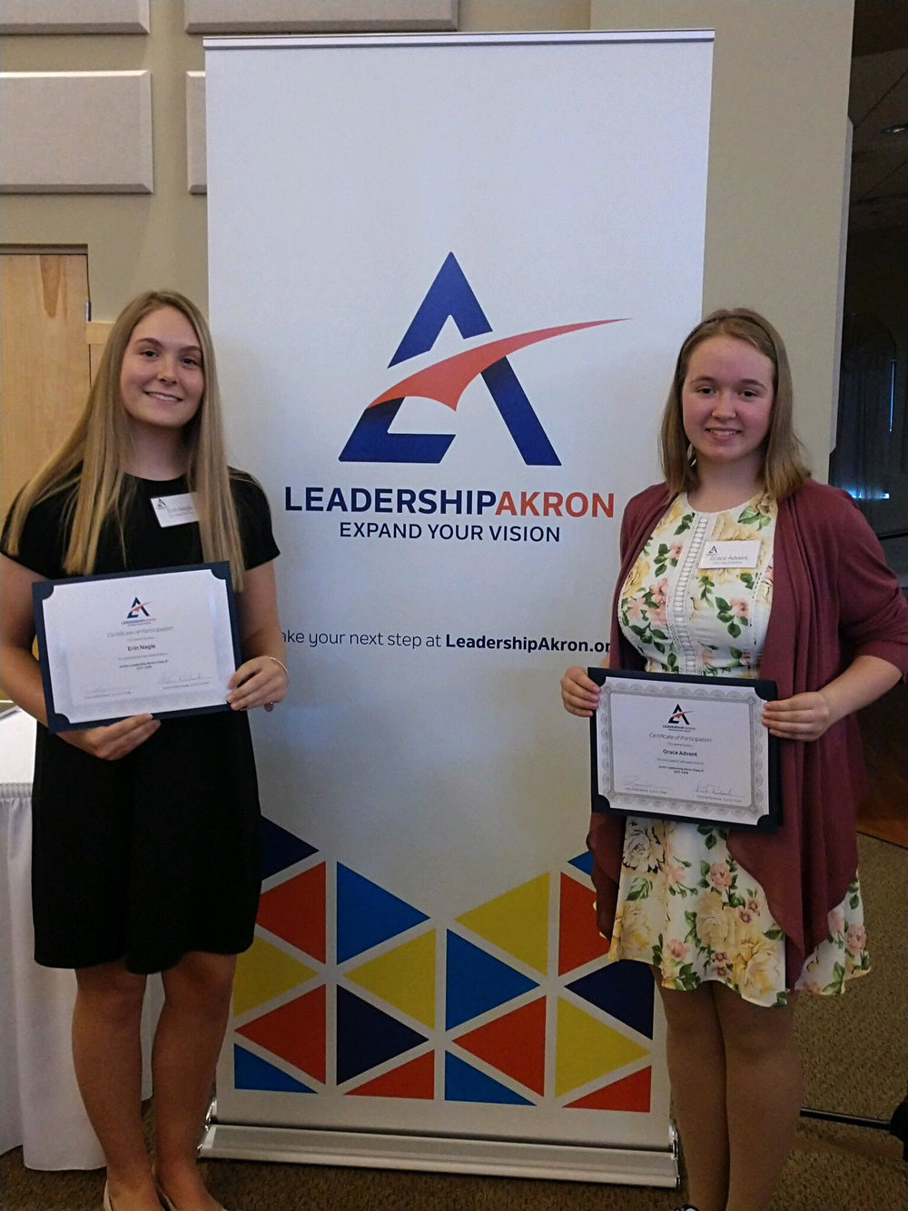 Erin Nagle  and  Grace Advent  display their diplomas from the Leadership Akron graduation ceremony.