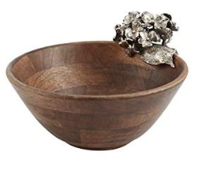 This mango wood bowl from Chez Del Interiors features individually crafted metal hydrangea blooms. Hand washing is recommended.