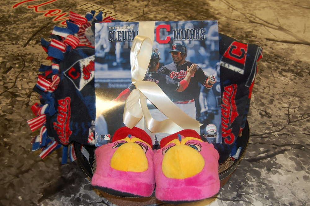 This Indians basket includes tickets to an Indians game, a blanket, slider slippers and a 2019 calendar.