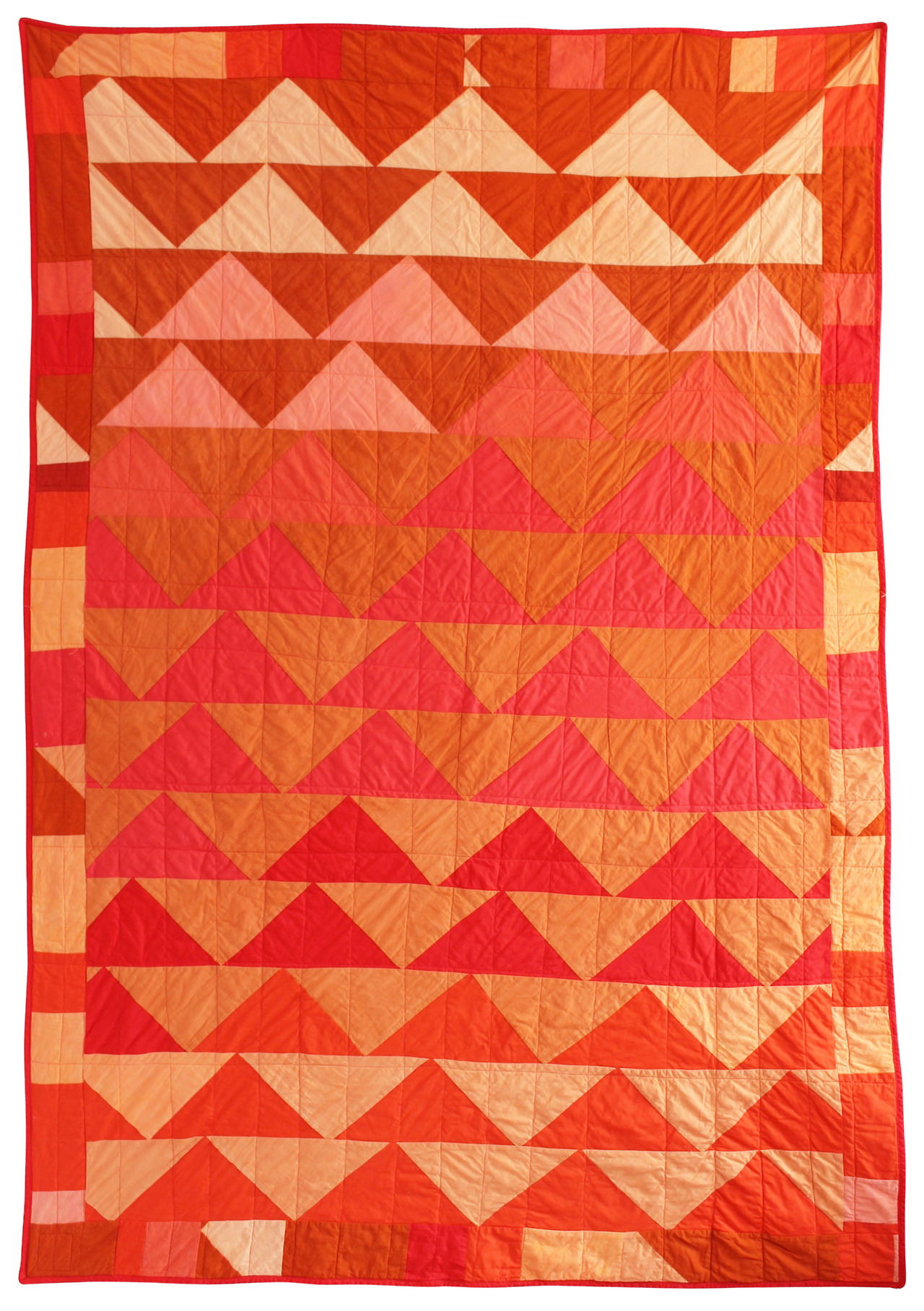 "Summer Night Quilt - 54"" x 80"" Since we're on the subject of summer cravings, I thought I'd tell you I've been craving S'mores lately. That may have something to do with the constant camp fire smell wafting into my apartment - residents of Bushwick love to cook outdoors in the summertime! One whiff of that smokey air and I'm instantly transported to camping trips of my childhood in Leo Carillo, California. We'd make S'mores as we watched the sunset, salty and hungry from swimming in the ocean all day. In this quilt I've built a campfire intuitively, almost unintentionally. Alas, my S'mores craving is still unsatisfied. Here. - Gina Rockenwagner"