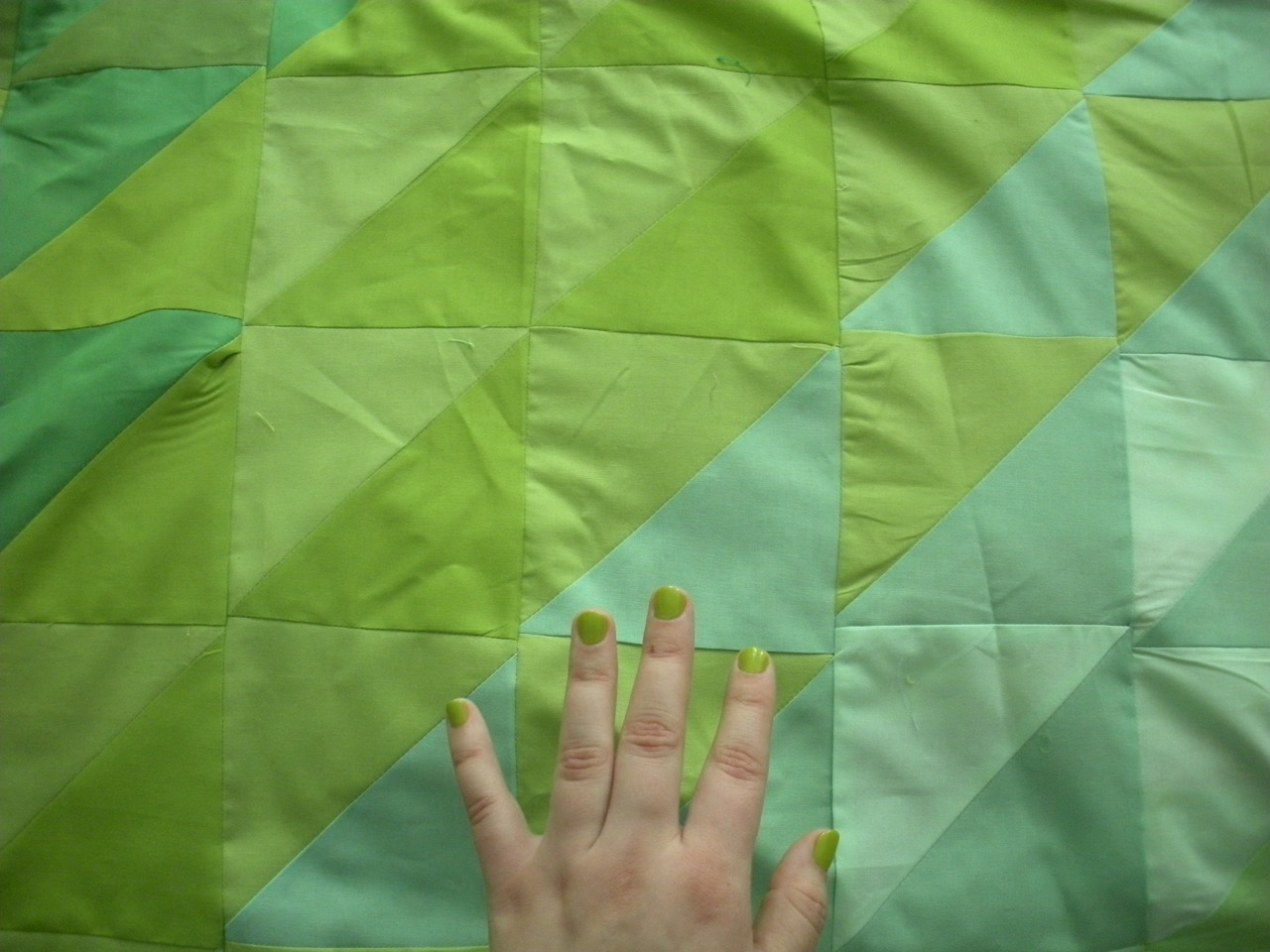My nail polish matches the quilt I am working on Color synchronicity, maybe. More likely cause: my undying attraction to the color green.