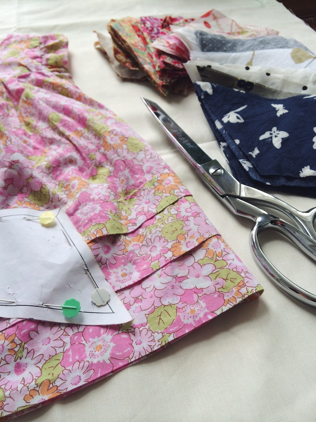 Cutting the most beautiful baby clothes to make a special quilt.