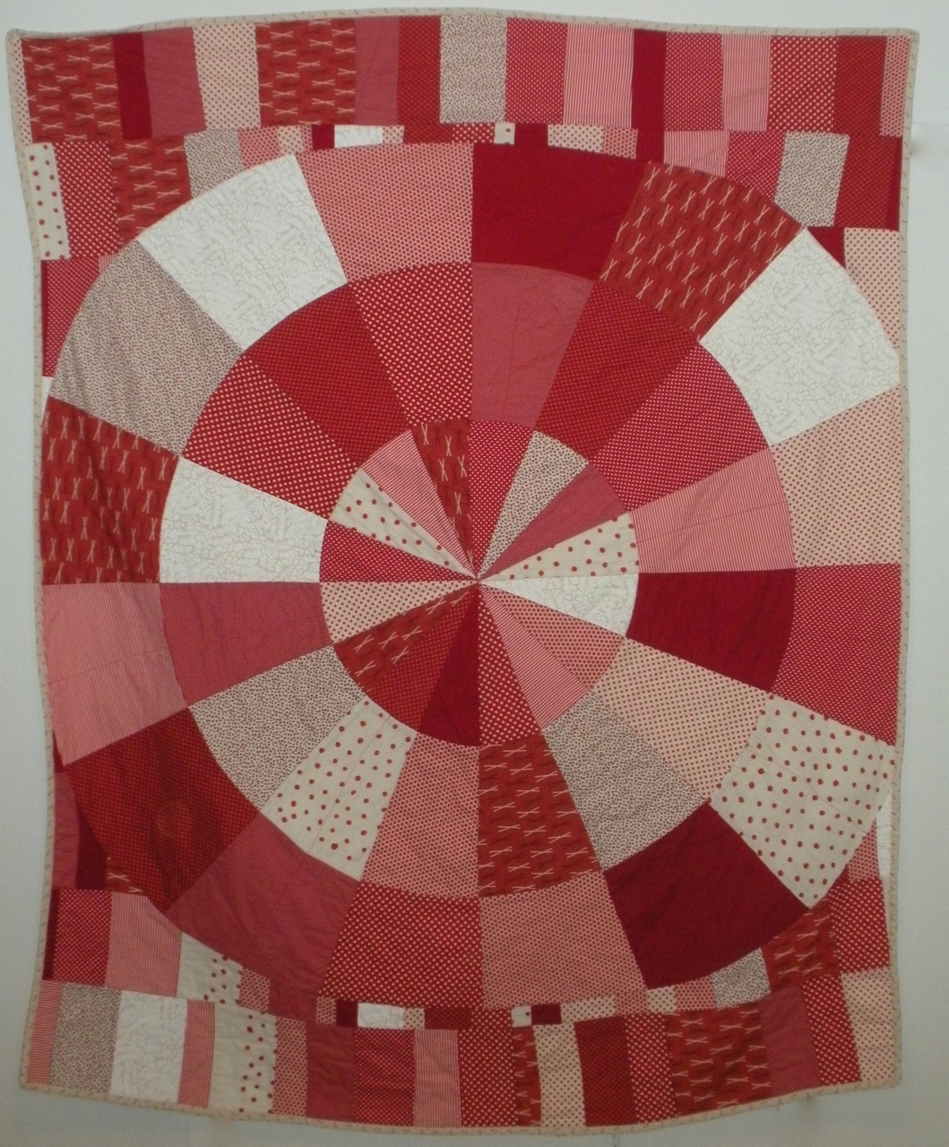"Back in March I had the pleasure of seeing Infinite Variety: Three Centuries of Red and White Quilts at the Armory. It inspired complete awe in me. So when it came time to make a quilt for a very special red-haired lady, I knew exactly what to make. I wanted to make something optical like many of the quilts in the show, but keep it very contemporary. I had a hard time giving it away! Approximately 70"" x 90"""