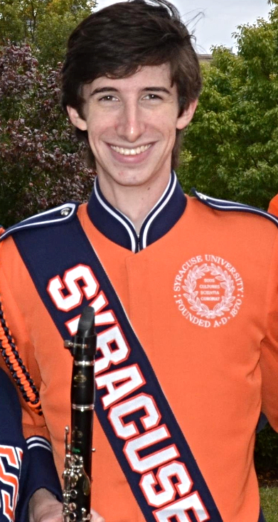 SPARE President and Director of  Into The Woods,  Brian Ives posing in his Syracuse University Marching Band Uniform.