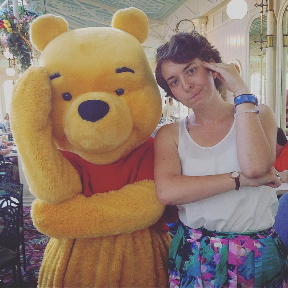 Erin does some thinkin' with Pooh Bear at Disney World