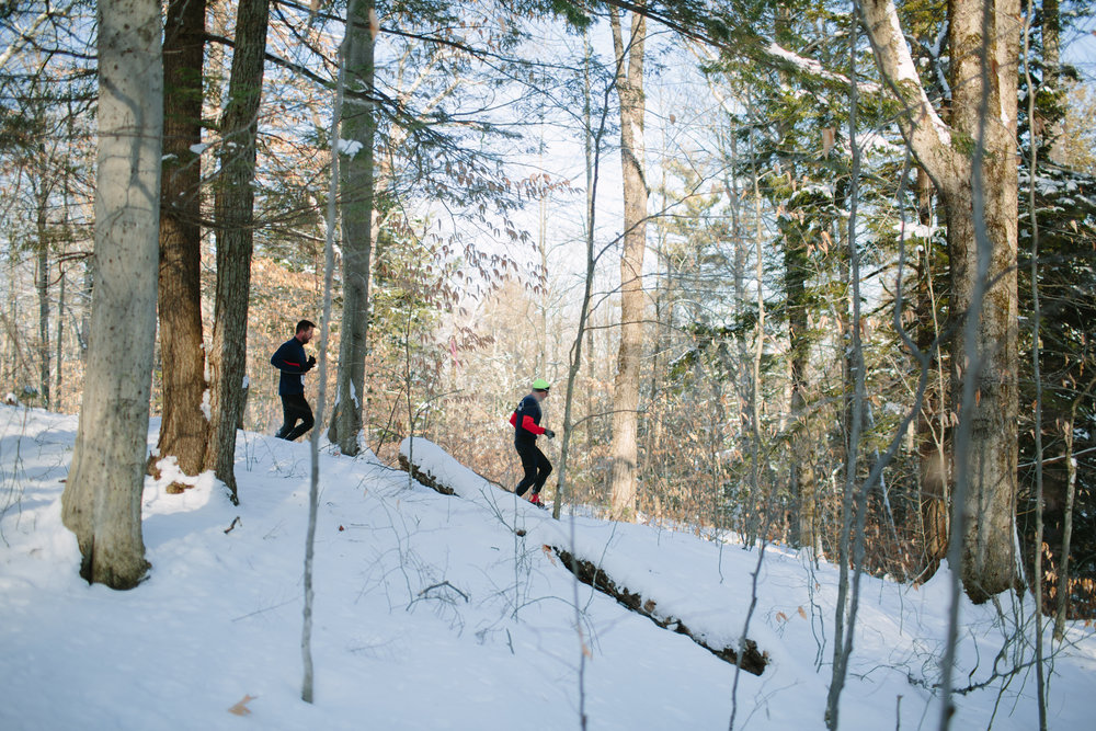 Snowshoe racers making their way through the wooded course in Wolfeboro, New Hampshire