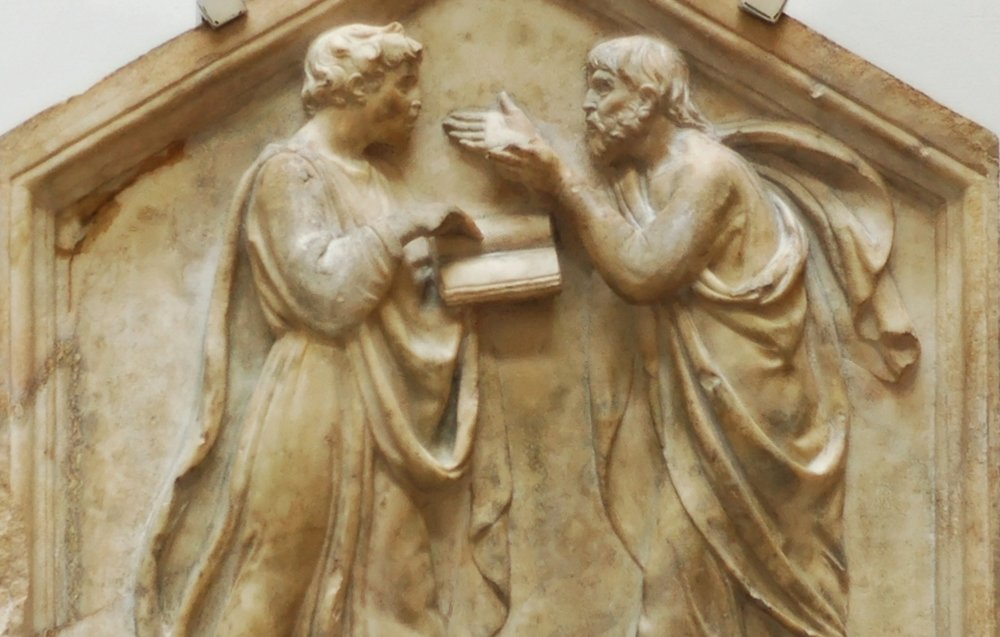 Plato and Aristotle in debate. 1430s Florentine carving by Luca della Robbia.