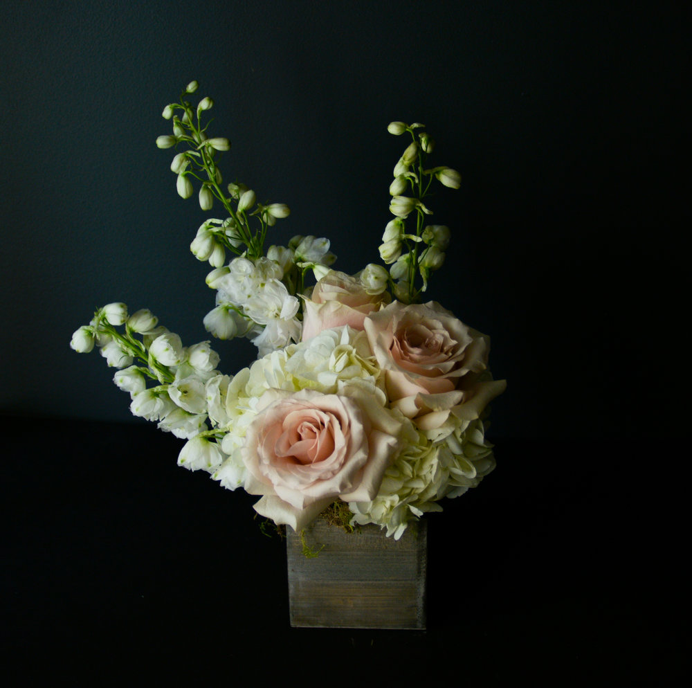 $50 Arrangement   A brilliant flower and greenery filled gift, perfect for a small mantle-piece, cubicle or desk brightener, and countertop decor. Always packed with the prettiest blooms of the day, and ready for any occasion.