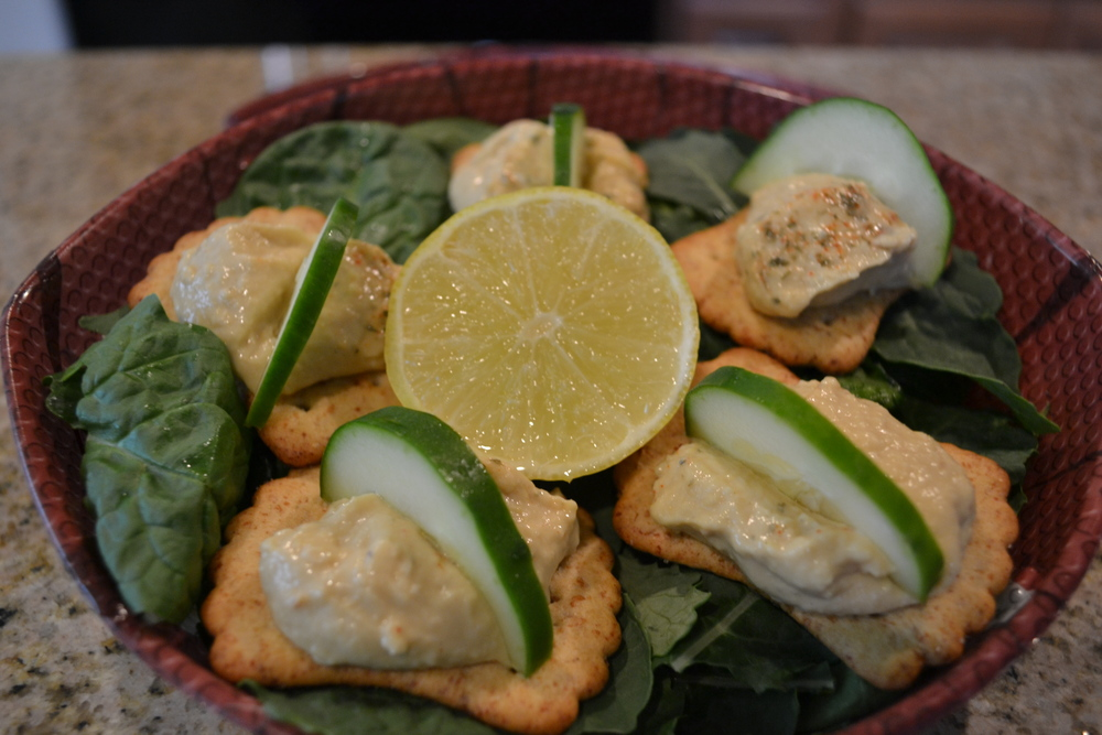 Perfect Snack - Organic hummus on delicious wheat crackers with refreshing cucumber slices.