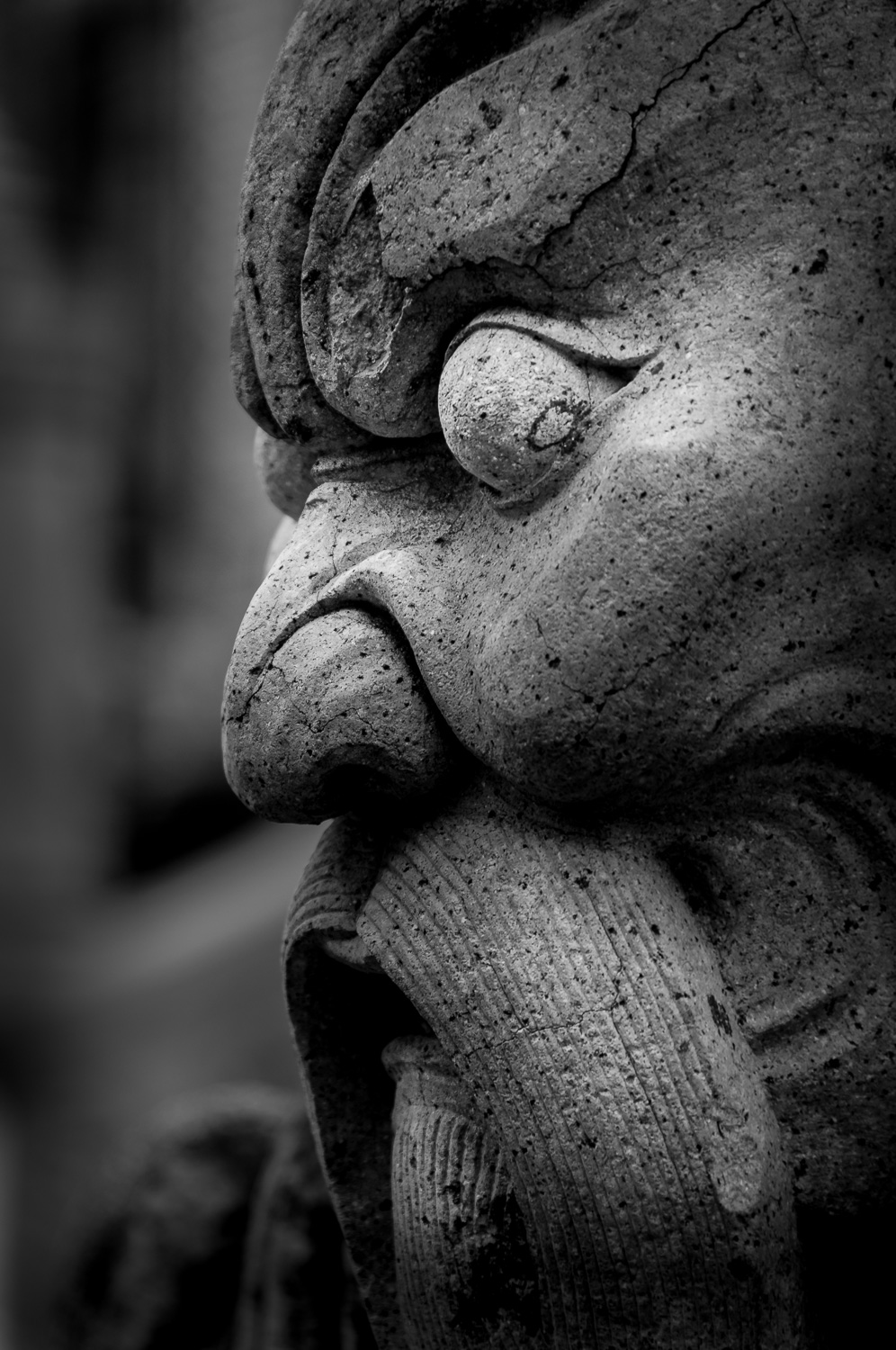 Stone Head Sculpture at the Temple of the Emerald Buddha - Bangkok