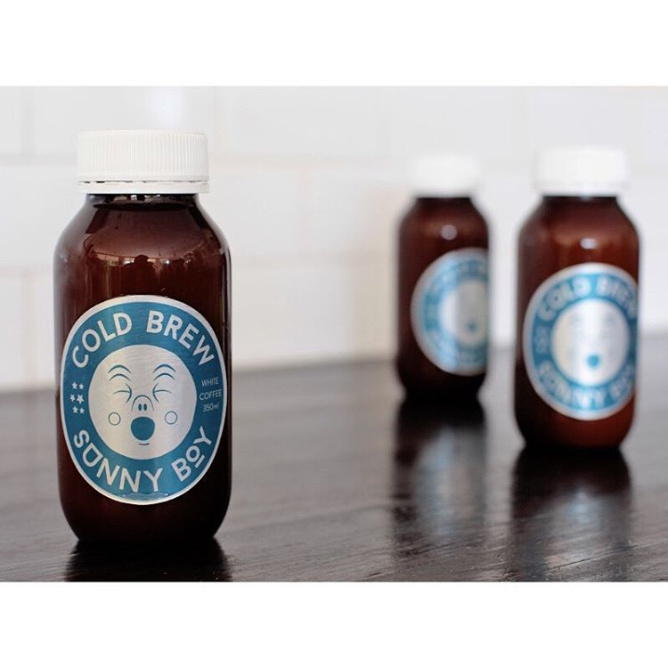 COLD BREW SUNNY BOY • Made from our super smooth Sunny Boy Original cold dripped over 5 hours, lightly sweetened and bottled in house daily. 350ml. Available black also. (at Sunshine Sunshine Espresso)