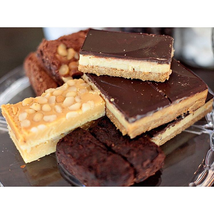 Got slice! Choose from Caramel Macadamia, Choc Caramel, Macadamia Brownie, or Raspberry Paleo Brownie. Open until 5pm. (at Sunshine Sunshine Espresso)