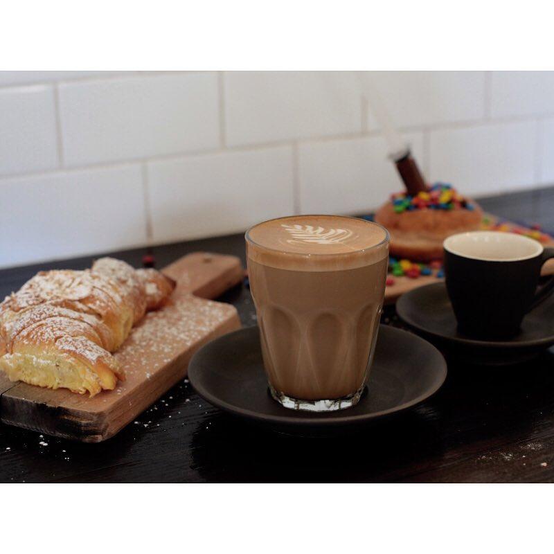 Tuesday's are like this. Sunny Boy Original latte, espresso, almond croissants, and Nutella M&M injectables. Open 6am - 5pm. Lomandra Drive, Currimundi. (at Sunshine Sunshine Espresso)