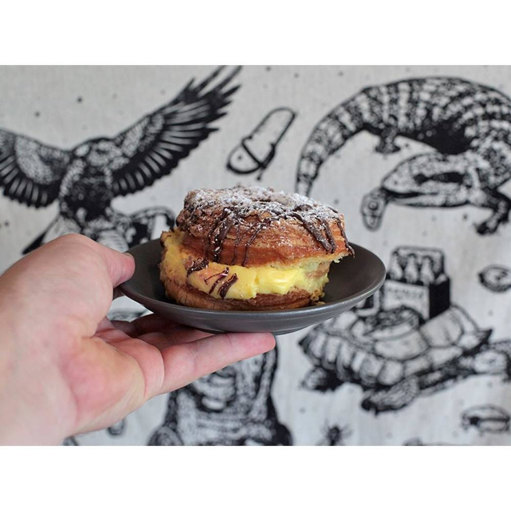 A handful of delicious Caramel Custard Cronuts have arrived.     Limited amounts so get in early. Open til 5pm. Lomandra Drive, Currimundi.