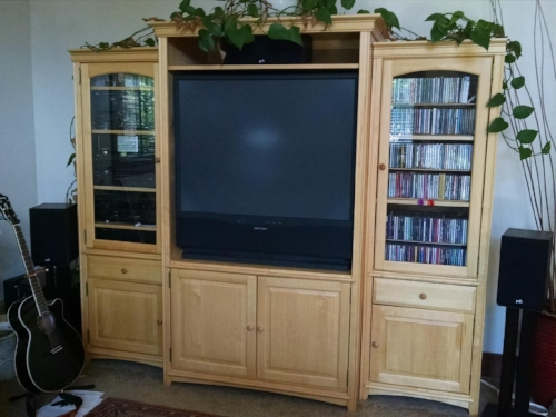 Now imagine the shelves filled with video games. Now stop laughing at how ugly 'entertainment centers' look.