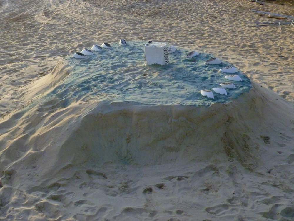 Guy Ben-Ari and Leah Wolff,  Time Loops - Human Sundial , 2011, Sand, plaster and acrylic paint, 5 x 14 x 14 ft