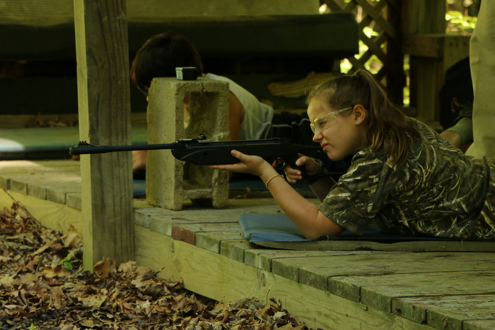 Girl taking aim at Rifelry week 7.JPG