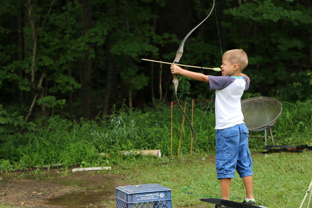 cute boy archery.JPG