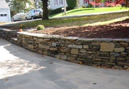 Driveway retaining wall - Grass Roots Landscaping