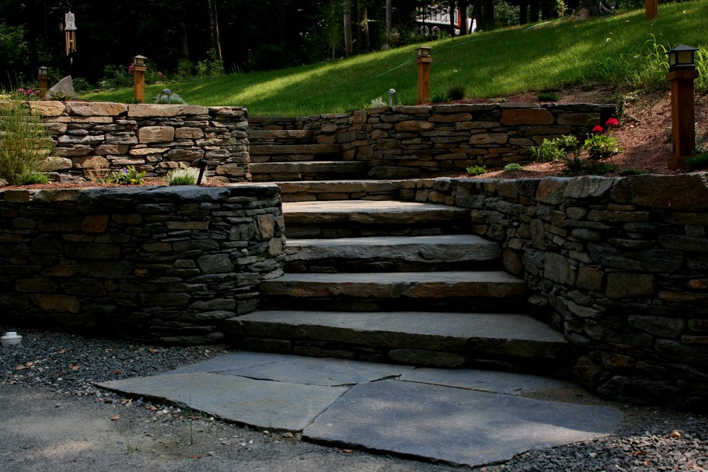Ware steps, landing and teraced retaining walls and beds.