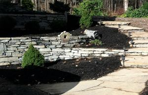Juggler meadow--mulched beds, terraced walls and stairs  Click on this image to reach gallery of single photos of landscaping jobs throughout the Pioneer Valley.