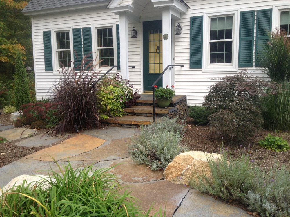 Strong Street, walkways, stairs with custom handrails, and landing  This photo also links to several landscaping jobs with single photos.