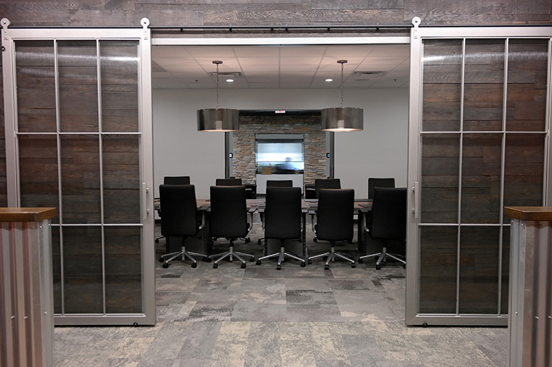 Conference Room: We had a blast working on this conference room for a Milwaukee-area Fortune 500 company's headquarters. Sliding doors, conference room table, and wood accent walls. Play video.