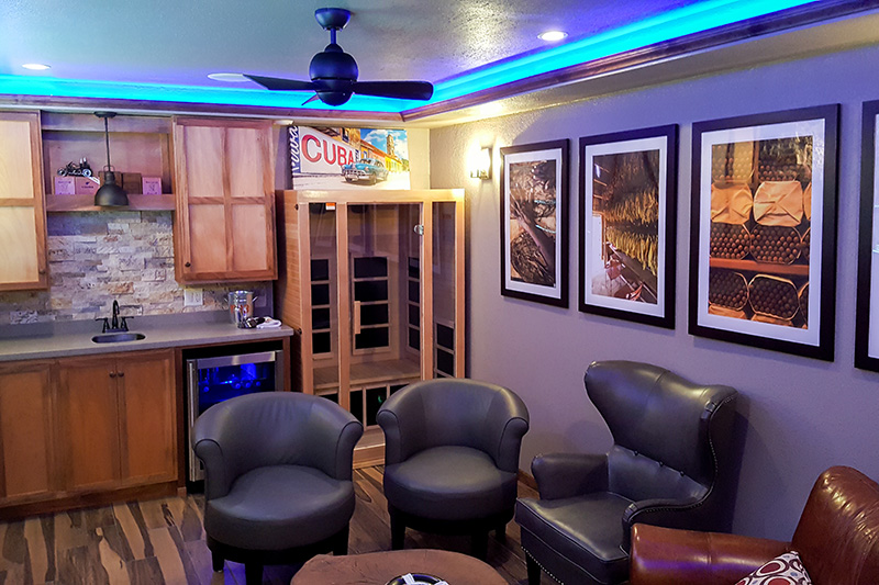 Cigar Lounge: We converted part of a garage into a functional cigar lounge and wet bar, complete with entertainment center, LED lighting, a crate wall, smoke pull for 6 people, and even a small sauna! See more.