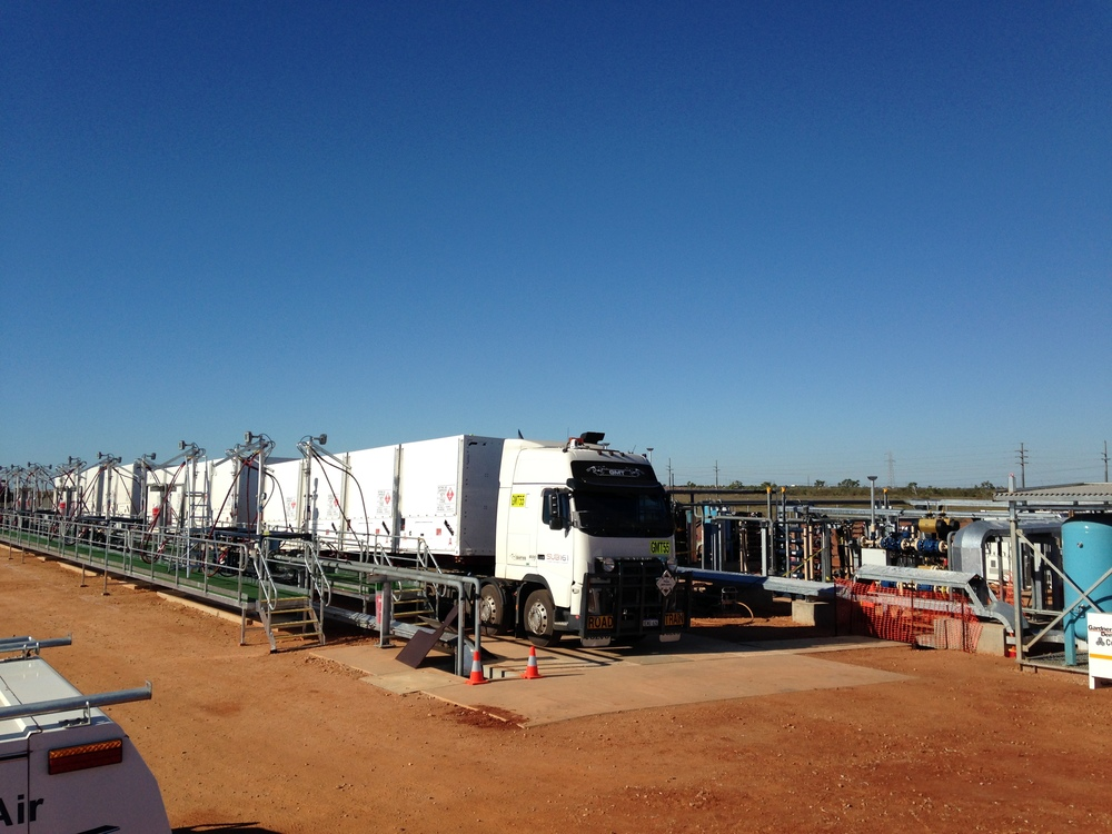 Port Hedland mother station site - quad road train parked next to fill panel