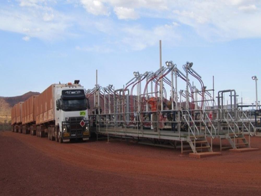 Quad road train and decanting skids