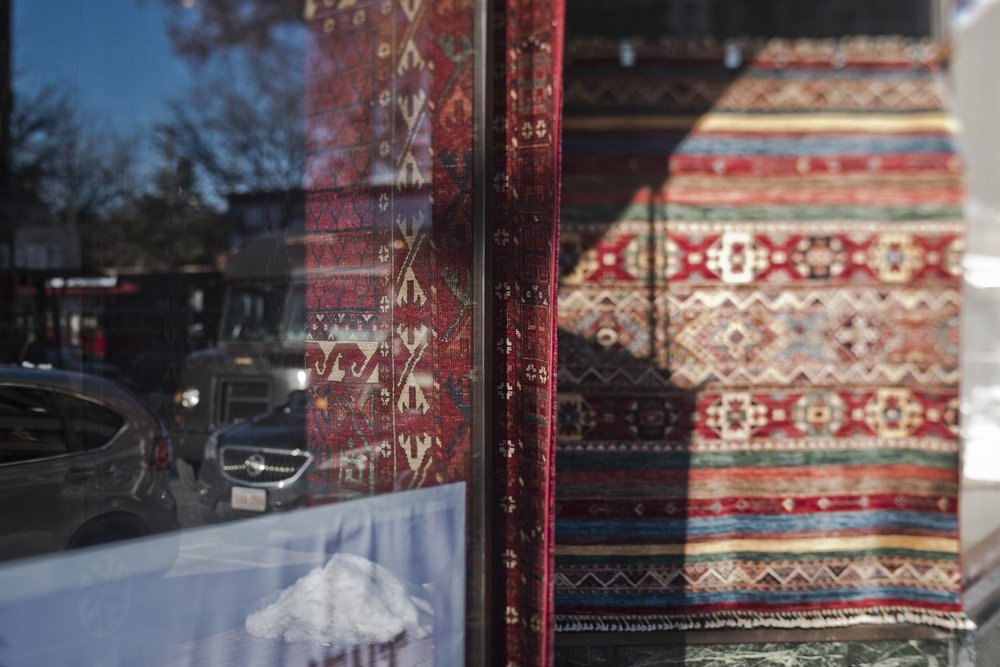 Red rugs in a store front