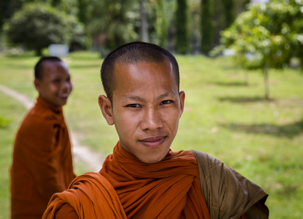 Serious and not so serious monks. Somewhere near Chau Doc. Vietnam.